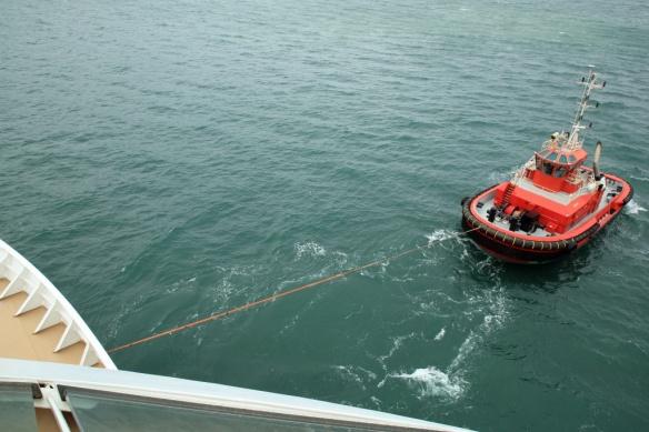 Bow tug pulling ship off the berth