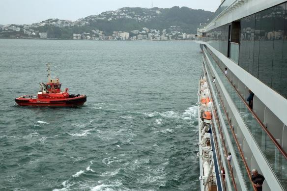 syern tug pulling ship off the berth