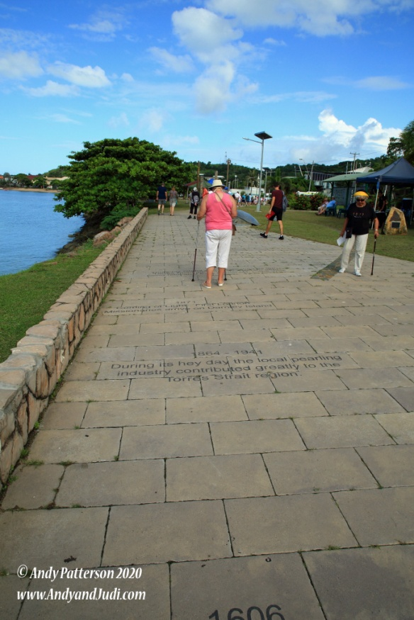 Walkway just off pier with historical facts