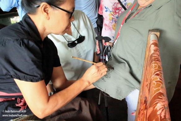 Batik - applying design to Judi's shirt 2