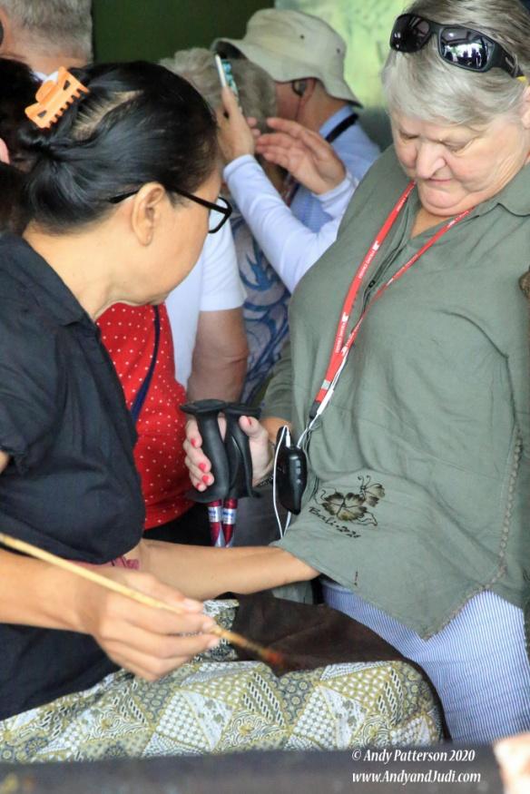 Batik - applying design to Judi's shirt 4