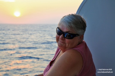 Judi on balcony at sunset