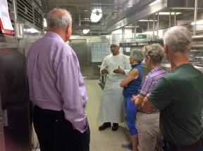 Galley chef explaining grill in Manfredi's galley